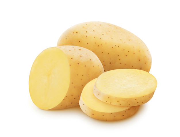 Raw potato isolated on white background with clipping path, pile of whole and sliced potatoes